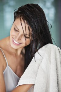 6 Everyday Tricks to Keep Your Hair Flyaways in Place