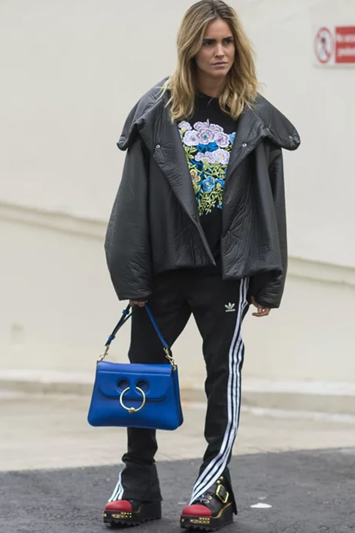 With Edgy Moto Boots, a Floral Sweatshirt, and Your Favorite Fancy Bag