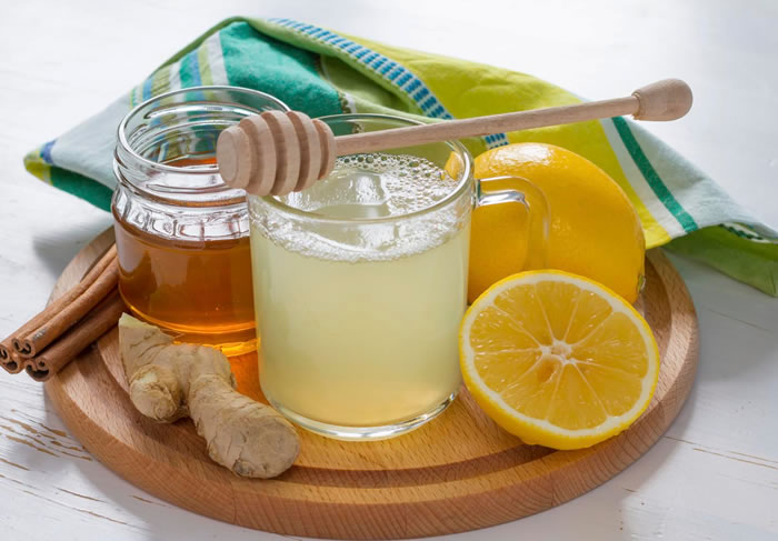 Natural waxing with honey and lemon for removing upper lip hair
