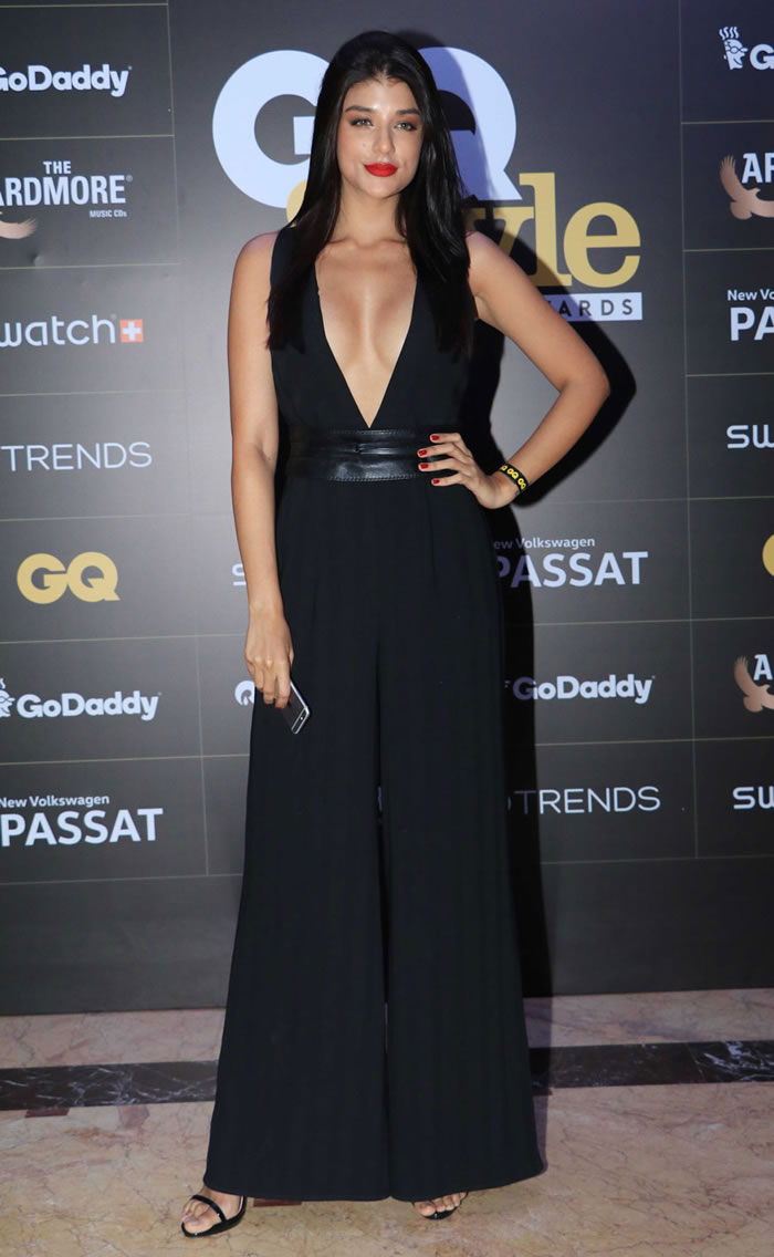 A guest poses for a photo on her arrival at the GQ Style Awards 2018 in Mumbai